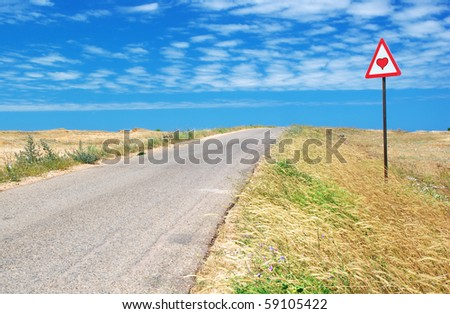 Road in desert and  traffic sign. Nature composition.