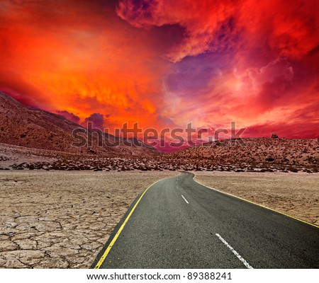 Road in desert on sunset - stock photo