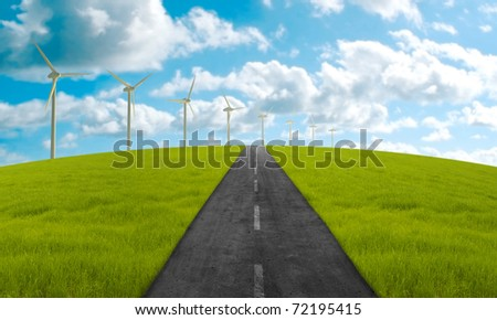 Road in green meadow towards the clean energy system - stock photo