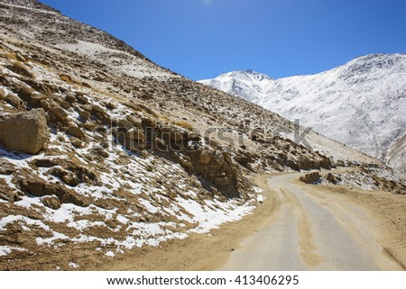 Road in himalayas with mountains - stock photo