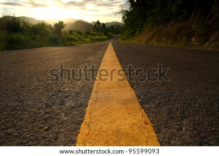 road in middle of rural area to morning - stock photo