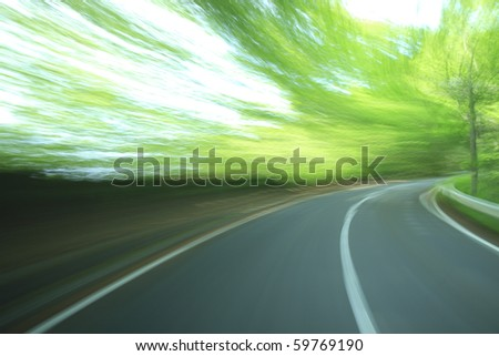 Road in motion blur - stock photo