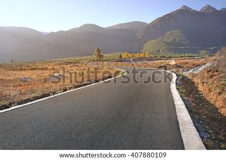 Road in mountain scenery - stock photo
