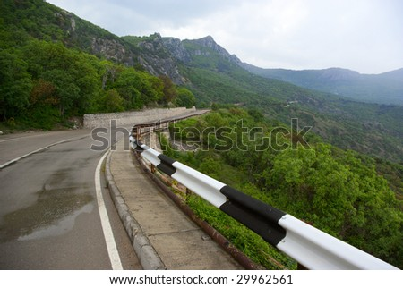 Road in mountains at rainy day