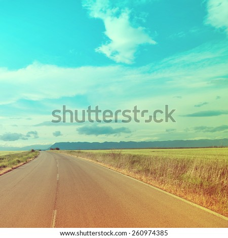 Road in mountains.Special toned photo in vintage style - stock photo