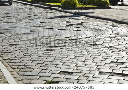 Road in need of repair - stock photo