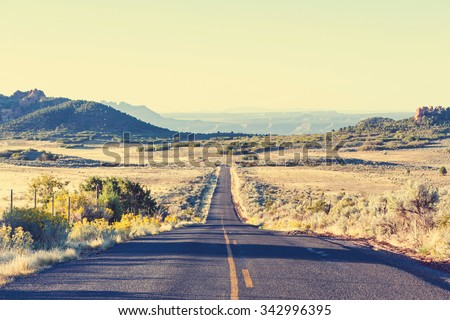 Road in prairie country - stock photo