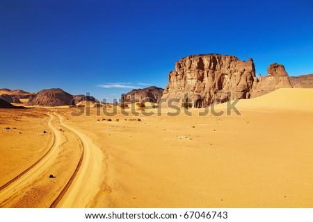 Road in Sahara Desert, Tadrart, Algeria - stock photo