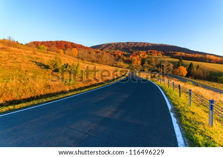 Road in sunrise light in Bieszczady Mountains in autumn, Poland
