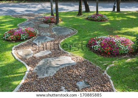 road in the beautiful and colorfull garden - stock photo