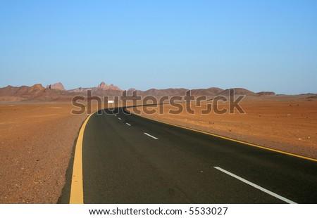Road in the desert. - stock photo
