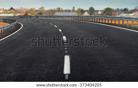 Road in the Fields of Tulips in Netherlands - stock photo
