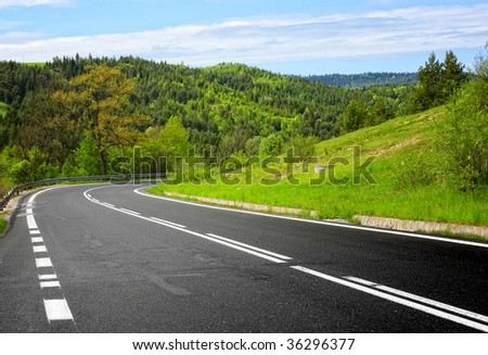 Road in the mountain - stock photo