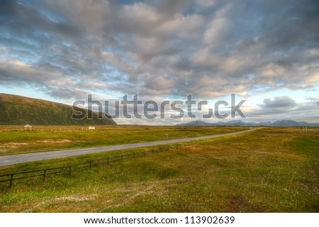 Road in the mountainous region to the north of Norway - stock photo
