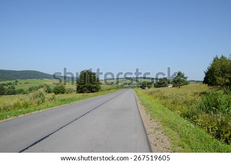 Road in the mountains (Bieszczady in Poland) - stock photo