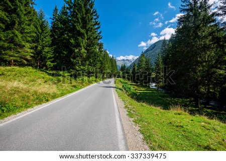 road in the mountains of the Alps in Austria - stock photo