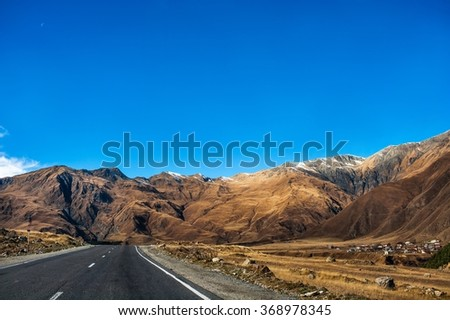 road in the mountains of the Caucasus in fall, Georgian Military Road - stock photo