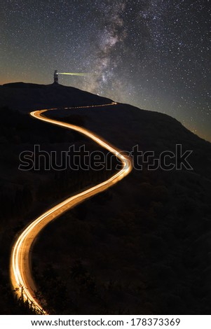 Road in the mountains under the Milky Way  - stock photo
