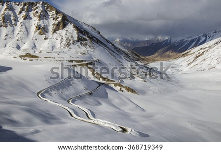 Road in the Snow Mountain from Khardung la top, Leh Ladakh, Jammu and Kashmir, India