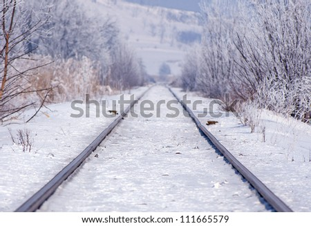 Road in winter with snow and fast moving car - stock photo