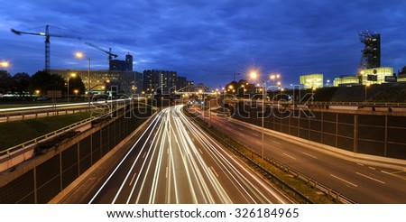 Road junction in the center of Katowice, Poland in the evening. - stock photo