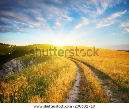 Road lane in mountain and deep blue sky. Nature composition. - stock photo