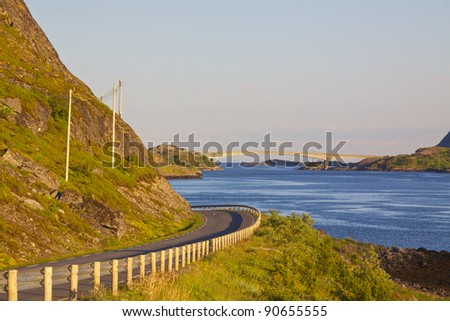 Road leading to a bridge on Lofoten Islands in Norway - stock photo