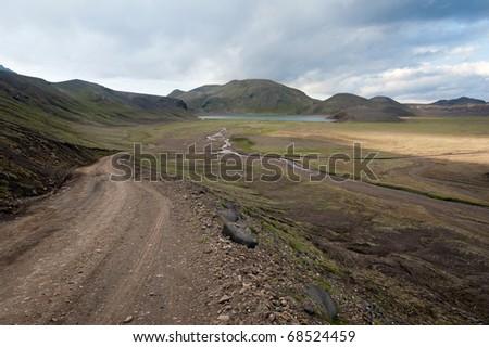 road leading to Landmannalaugar - colored mountains on Iceland - stock photo