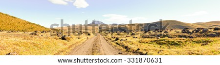Road Leading To Sincholagua Volcano Many Volcanic Eruption Marks Large Stone Resulting From Volcanic Activities - stock photo