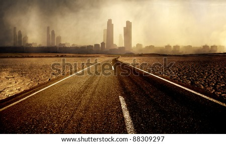 Road leading to the city with pollution - stock photo