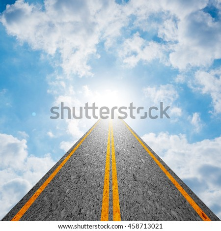 Road leading to the cloudy sky and the sun shining bright light at the end of the road. Representing success, religion, holy, faith, belief, spiritual concept - stock photo