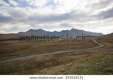 road leading to the mountains on the isle of skye - stock photo