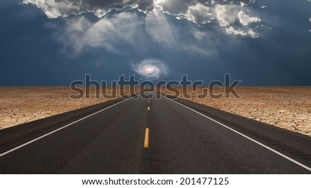 Road leads into desert toward galaxy above horizon Elements of this image furnished by NASA - stock photo