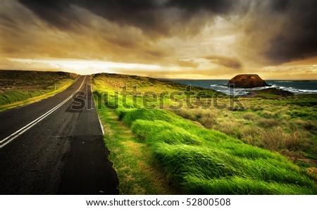 Road leads to a beautiful coastline - stock photo