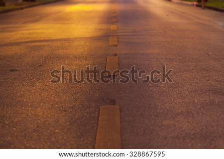 road lighting, the light comes from. Orange glow of the fire was emblazoned on the side of the road. - stock photo