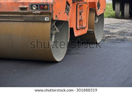 Road making with heavy machines,roller for mastic asphalt paving - stock photo