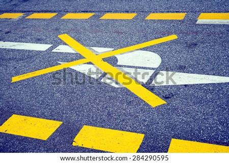 Road marking, arrow symbol - stock photo