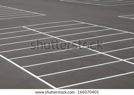 Road marking on the asphalted parking place - stock photo
