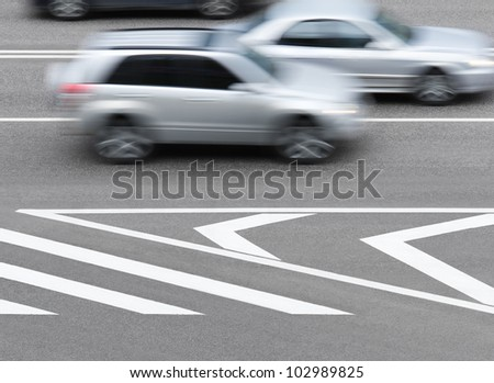 Road markings and cars. Abstract background. - stock photo