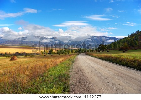 Road, mountains and skies. Altay - stock photo