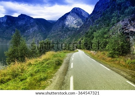 Road next to Aurlandsfjord - fiord landscape in Sogn og Fjordane region, Norway. Filtered color style. - stock photo