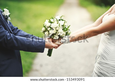road of love and happiness, hands of a newly wed couple together - stock photo