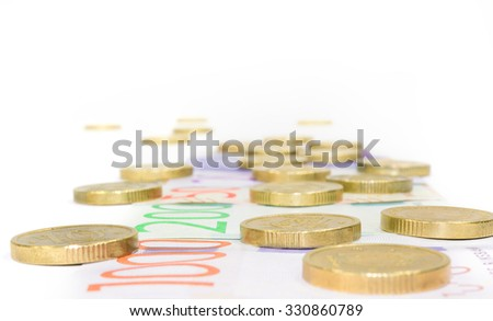 Road of money, new swedish bank notes and coins - stock photo