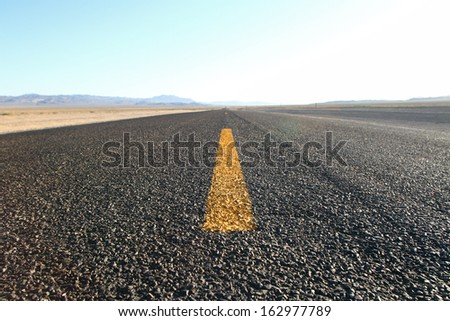 Road on infinite roads through the wilderness - stock photo