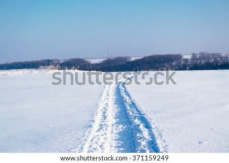 Road on snow - stock photo