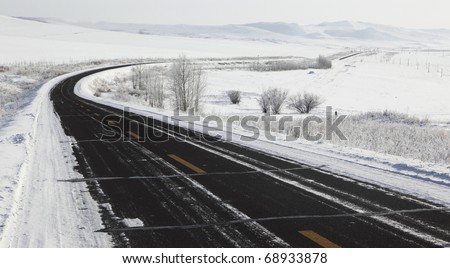 road on snow in the northeast of china - stock photo