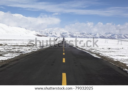 road on the altiplano in the northwest of china - stock photo