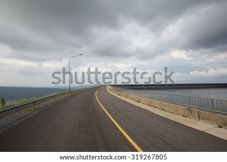 Road on the ridge of Lam Takong reservoir dam, Nakhon Ratchasima, Thailand
