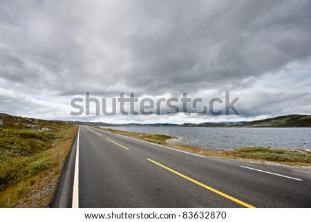 Road over mountain passage between Oslo and Bergen in Norway - stock photo