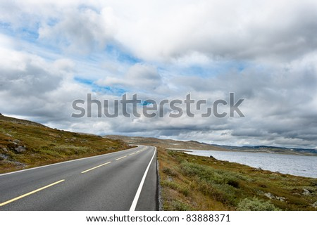 Road over rural landscape on the mountain between Oslo and Bergen in Norway - stock photo